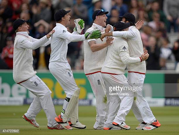 Moeen Ali of England is modded by teammates after catching out Trent Boult of New Zealand to win the 1st Investec Test match between England and New...