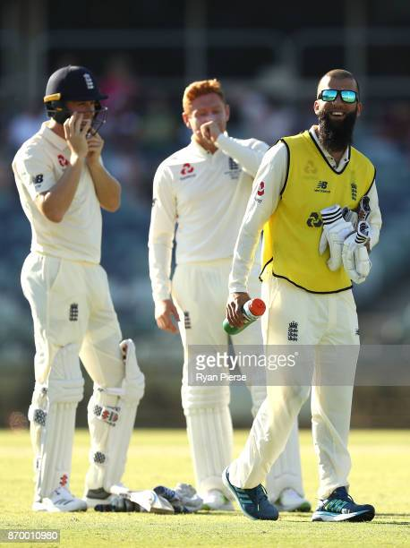 Moeen Ali of England runs drinks to Gary Ballance and Dawid Malan of England during day one of the Ashes series Tour Match between Western Australia...