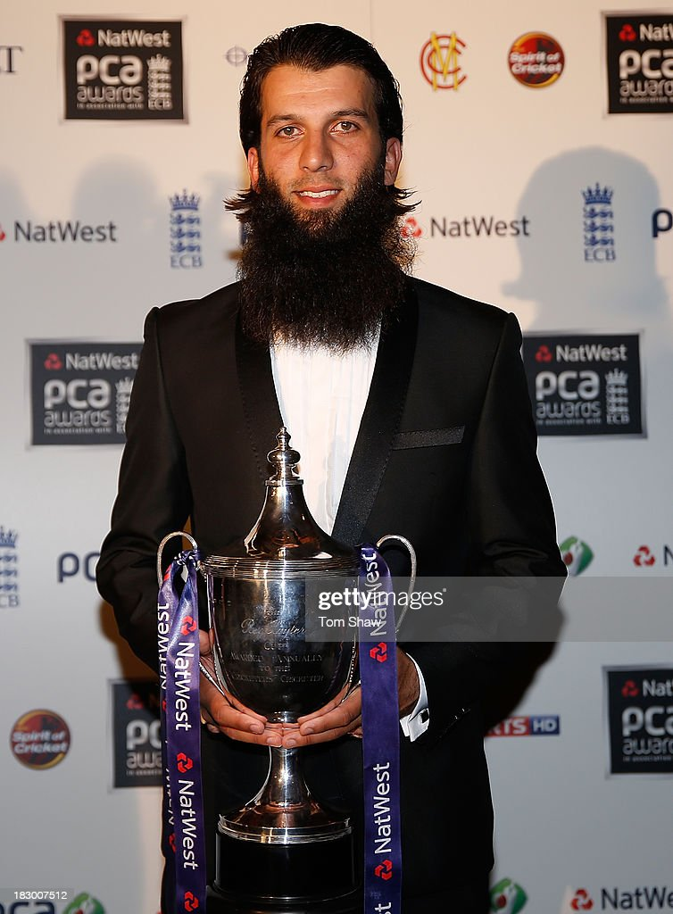 <a gi-track='captionPersonalityLinkClicked' href=/galleries/search?phrase=Moeen+Ali&family=editorial&specificpeople=571813 ng-click='$event.stopPropagation()'>Moeen Ali</a> of Worcestershire poses with the Reg Hayter Cup for the NatWest PCA Player of the Year during the Natwest PCA Awards dinner at The Roundhouse on October 3, 2013 in London, England.