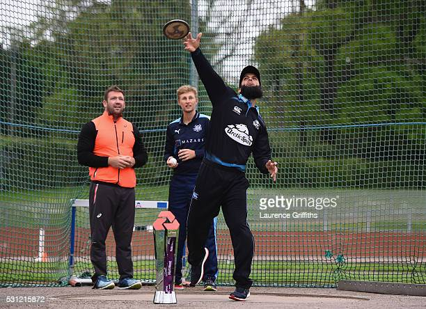 Moeen Ali of Worcestershire throws a discus watched by discus thrower Dan Greaves of Great Britain and Joe Root of Yorkshire during the NatWest T20...