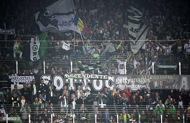 Moenchengladbach fans celebrate after the German first division Bundesliga football match SV Werder Bremen vs Borussia Moenchengladbach in Bremen...