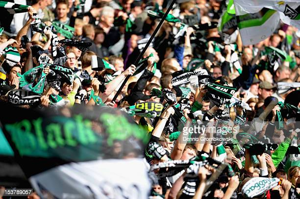 Moenchengladbach supporters cheer during the Bundesliga match between VfL Borussia Moenchengladbach and Eintracht Frankfurt at Borussia Park Stadium...