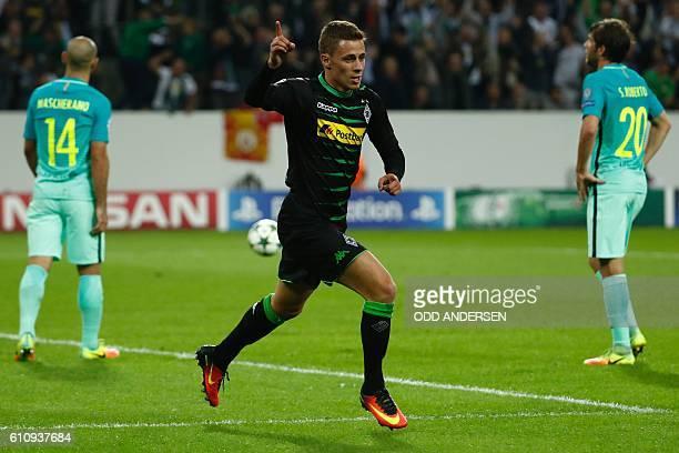 Moenchengladbach's Belgian midfielder Thorgan Hazard celebrates after scoring the opening goal during the UEFA Champions League firstleg group C...