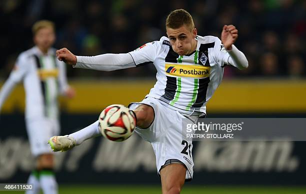 Moenchengladbach's Belgian midfielder Thorgan Hazard plays the ball during the German first division Bundesliga football match Borussia...