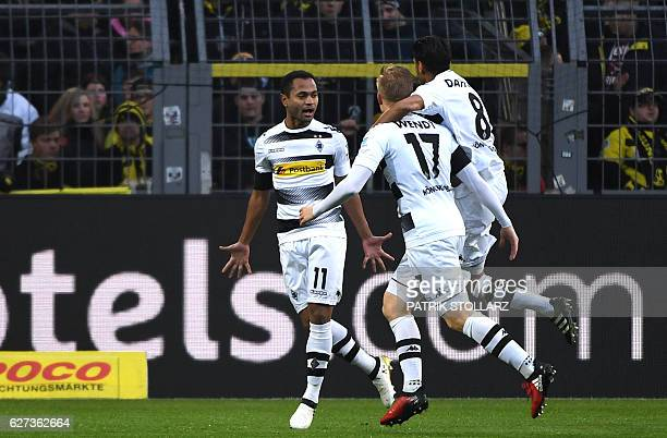 Moenchengladbach's Brazilian midfielder Raffael and his teammates celebrate during the German first division Bundesliga football match between...