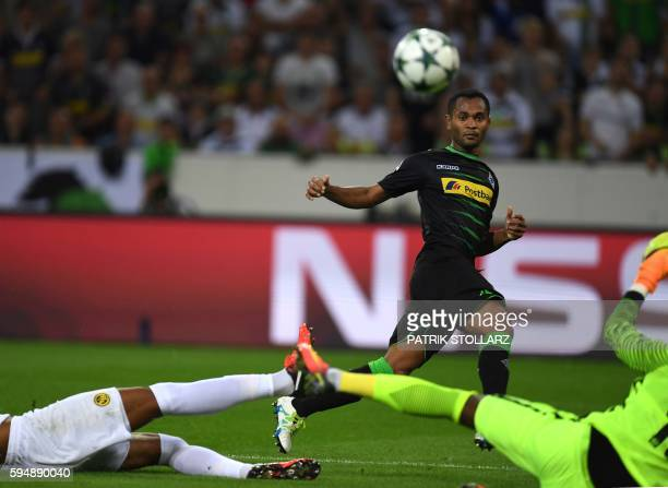 Moenchengladbach's Brazilian midfielder Raffael scores against Yvom Mvogo of Young Boys during Champions League first playoff round football match...