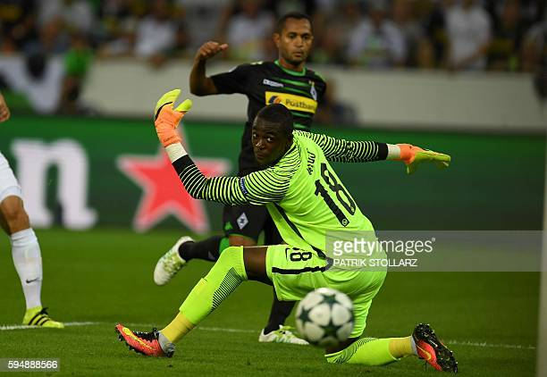 Moenchengladbach's Brazilian midfielder Raffael vies with Yvon Mvogo of Young Boys during Champions League first playoff round football match between...