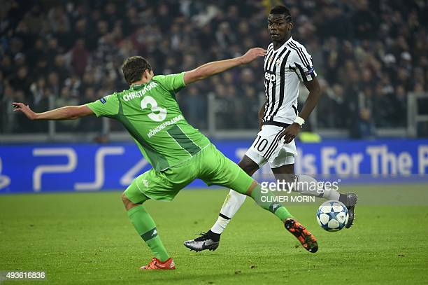 Moenchengladbach's Danish defender Andreas Bodtker Christensen vies with Juventus' midfielder from France Paul Pogba during the UEFA Champions League...