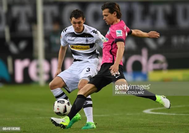 Moenchengladbach's Danish defender Andreas Christensen and Hertha's Swiss midfielder Valentin Stocker vie for the ball during the German first...