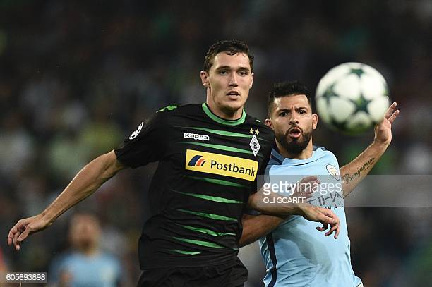 Moenchengladbach's Danish defender Andreas Christensen and Manchester City's Argentinian striker Sergio Aguero chase the ball during the UEFA...