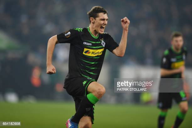 Moenchengladbach's Danish defender Andreas Christensen celebrates scoring the opening goal during the UEFA Europa League Round of 16 2nd leg football...