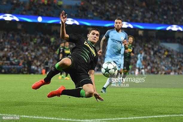 Moenchengladbach's Danish defender Andreas Christensen tries to keep the ball in play during the UEFA Champions League group C football match between...