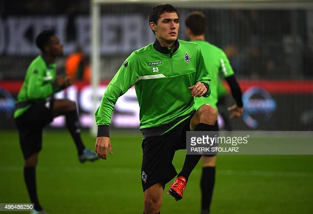 Moenchengladbach's Danish defender Andreas Christensen warms up prior to the UEFA Champions League Group D secondleg football match Borussia...
