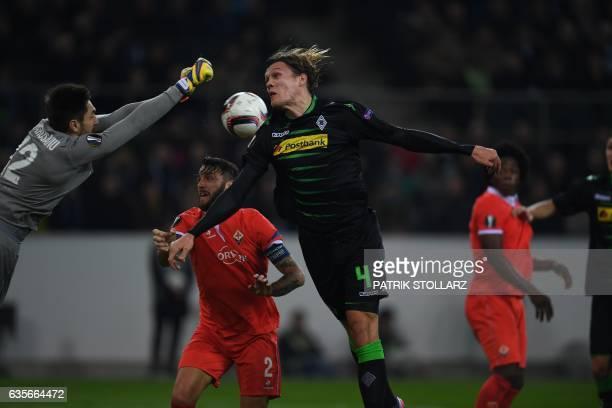 Moenchengladbach's defender Jannik Vestergaard vies for the ball during the UEFA Europa League round of 32 firstleg football match between Borussia...