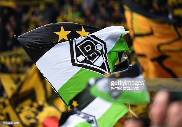 Moenchengladbach´s fans wave flags during the German first division Bundesliga football match between Borussia Moenchengladbach v Borussia Dortmund...