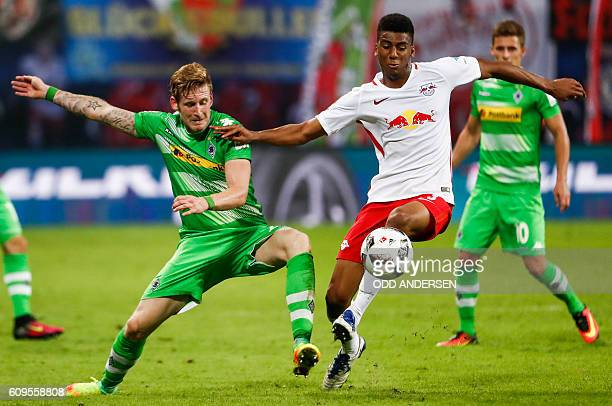 Moenchengladbach's forward Andre Hahn and RB Leipzig's Brazilian defender Bernardo Fernandes da Silva Junior vie for the ball during the German first...