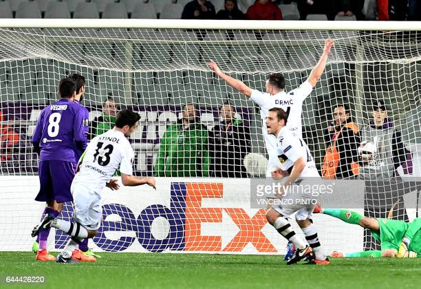 Moenchengladbach's forward Lars Stindl celebrates after scores during the UEFA Europa League round of 32 secondleg football match between Fiorentina...