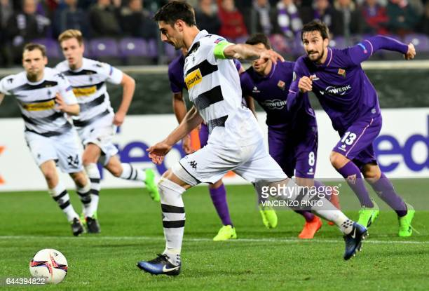 Moenchengladbach's forward Lars Stindl hits a penalty kick before scoring during the UEFA Europa League round of 32 secondleg football match between...