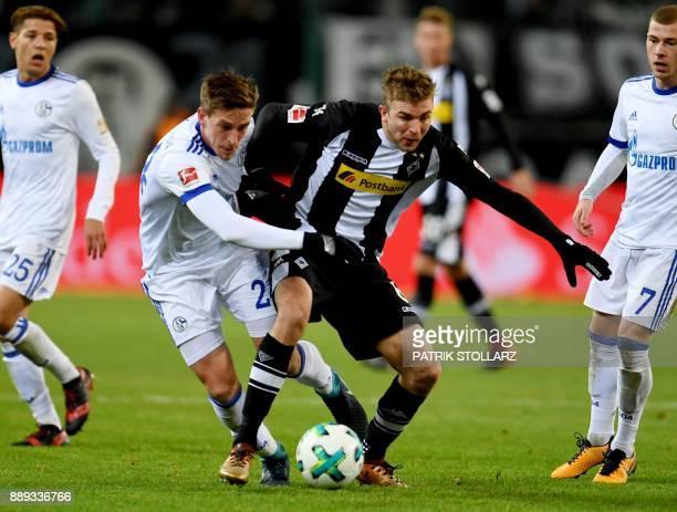 Moenchengladbach's German midfielder Christoph Kramer and Schalke's German defender Bastian Oczipka vie for the ball during the German first division...