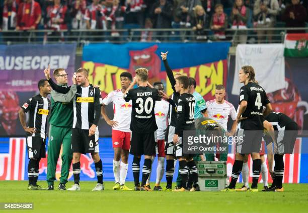 Moenchengladbach´s German midfielder Christoph Kramer is taken care of after a heavy foul by Leipzig´s Guinean midfielder Naby Deco Keita during the...