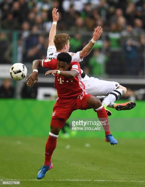 Moenchengladbach's midfielder Andre Hahn and Bayern Munich's Austrian midfielder David Alaba vie for the ball during the German first division...