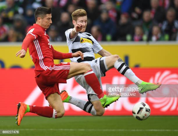 Moenchengladbach's midfielder Andre Hahn and Bayern Munich's Polish striker Robert Lewandowski vie for the ball during the German first division...