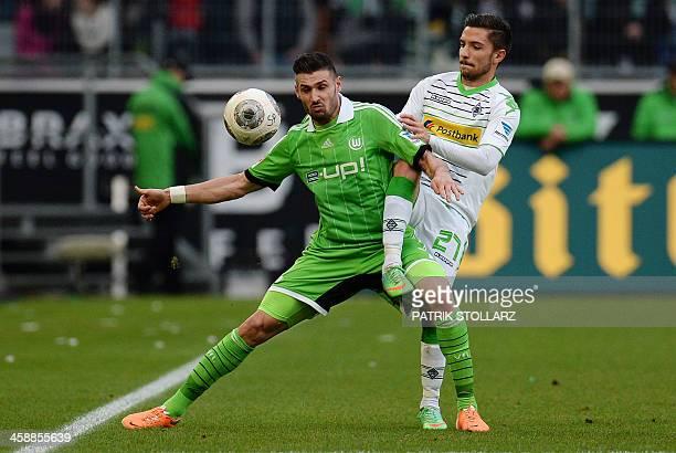 Moenchengladbach's midfielder Julian Korb and Wolfsburg's midfielder Daniel Caligiuri vie for the ball during the German first division Bundesliga...