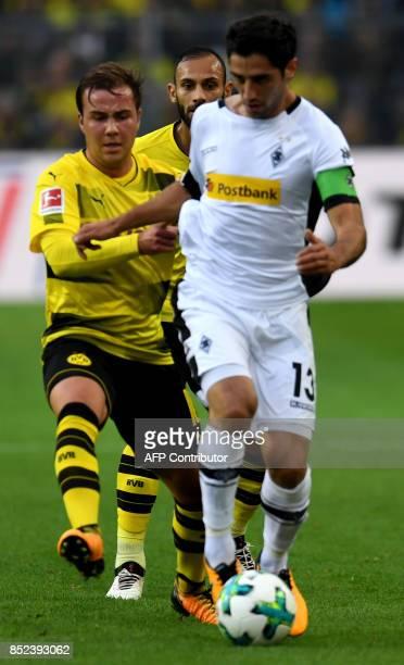 Moenchengladbach's midfielder Lars Stindl and Dortmund's midfielder Mario Goetze vie for the ball during the German First division Bundesliga...