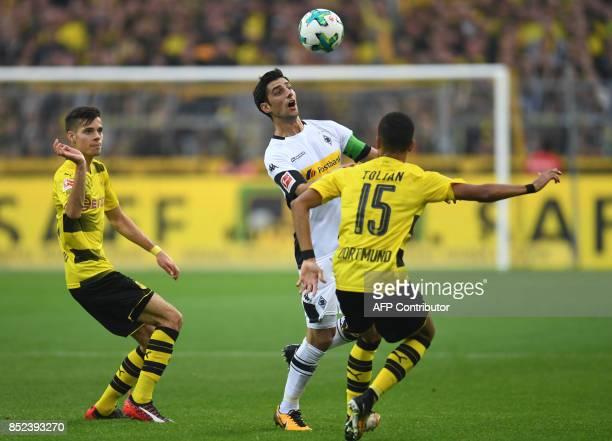 Moenchengladbach's midfielder Lars Stindl and Dortmund's midfielder Jeremy Toljan vie for the ball during the German First division Bundesliga...
