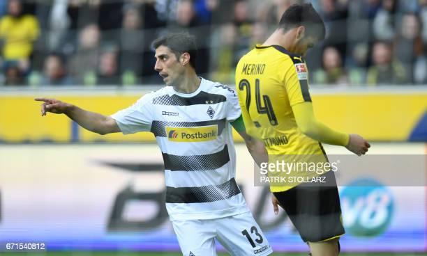 Moenchengladbach's midfielder Lars Stindl celebrate after scoring during the German first division Bundesliga football match Borussia...