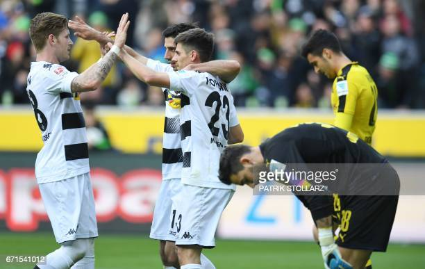 Moenchengladbach's midfielder Lars Stindl celebrate after scoring with his teammates during the German first division Bundesliga football match...