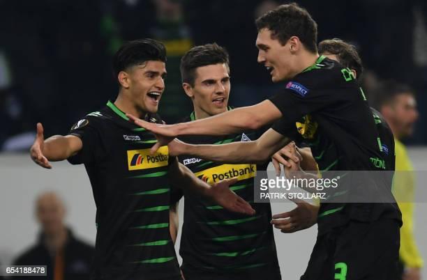 Moenchengladbach's midfielder Mahmoud Dahoud celebrates scoring the 2/0 goal with his teammates during the UEFA Europa League Round of 16 2nd leg...