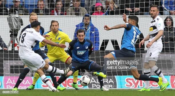 Moenchengladbach's midfielder Mahmoud Dahoud scores the 43 during the German First division Bundesliga football match between TSG Hoffenheim and...