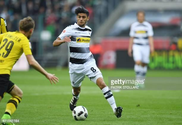 Moenchengladbach's midfielder Mahmoud Dahoud vies during the German first division Bundesliga football match Borussia Moenchengladbach v BVB Borussia...