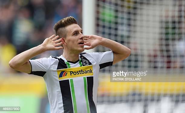 Moenchengladbach's midfielder Patrick Herrmann celebrates after scoring 20 during the German first division Bundesliga football match between...
