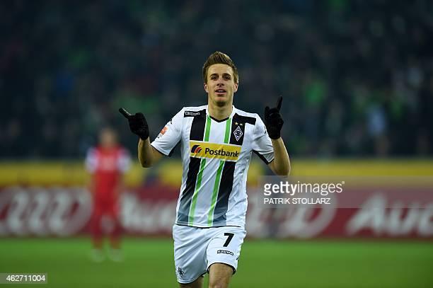 Moenchengladbach's midfielder Patrick Herrmann celebrates after scoring during the German first division Bundesliga football match Borussia...