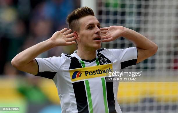 Moenchengladbach's midfielder Patrick Herrmann celebrates during the German first division Bundesliga football match between Borussia...