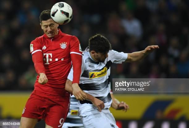 Moenchengladbach's midfielder Tobias Strobl and Bayern Munich's Polish striker Robert Lewandowski vie for the ball during the German first division...