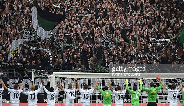 Moenchengladbach's players and fans celebrate after the German first division Bundesliga football match between Borussia Moenchengladbach and VfL...