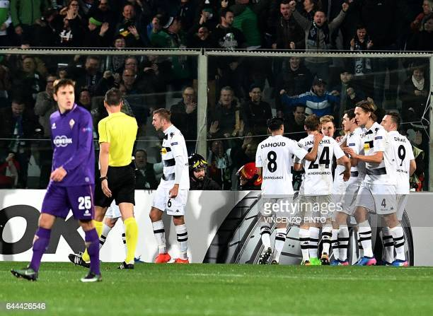 Moenchengladbach's players celebrate after scores during the UEFA Europa League round of 32 secondleg football match between Fiorentina and Borussia...