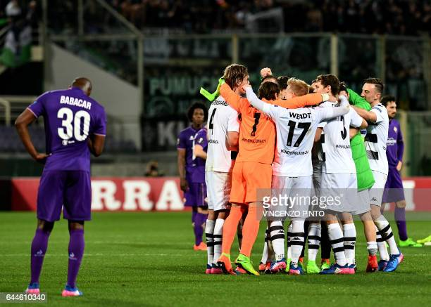 Moenchengladbach's players celebrates defeating Fiorentina in the UEFA Europa League round of 32 secondleg football match between Fiorentina and...