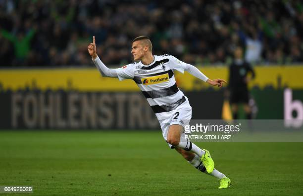 Moenchengladbach's Slovak midfielder Laszlo Benes celebrates scoring with his teammates during the German first division Bundesliga football match of...