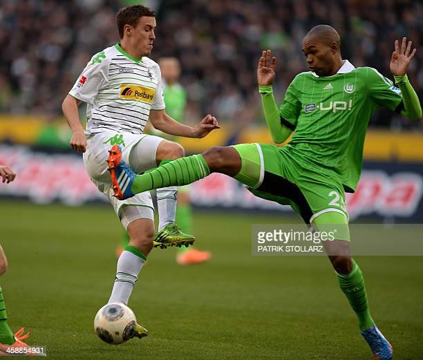 Moenchengladbach's striker Max Kruse and Wolfsburg's Brazilian defender Naldo vie for the ball during the German first division Bundesliga football...