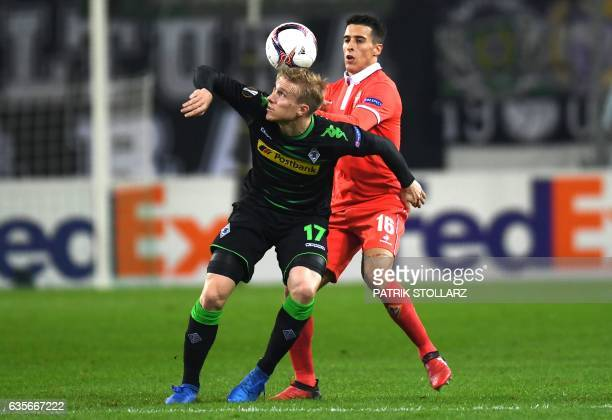 Moenchengladbach's Swedish defender Oscar Wendt and Fiorentina's midfielder from Mexico Carlos Salcedo vie for the ball during the UEFA Europa League...