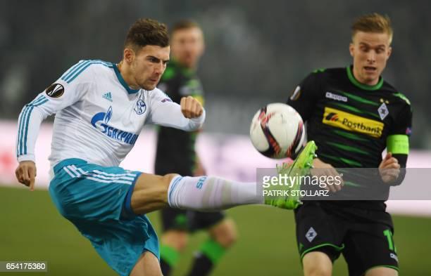 Moenchengladbach's Swedish defender Oscar Wendt and Schalke's midfielder Leon Goretzka vie for the ball during the UEFA Europa League Round of 16 2nd...