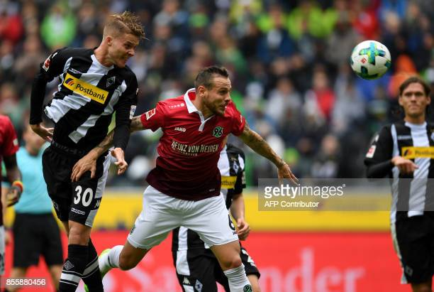 Moenchengladbach's Swiss defender Nico Elvedi hits the ball during the German first division Bundesliga football match between Borussia...