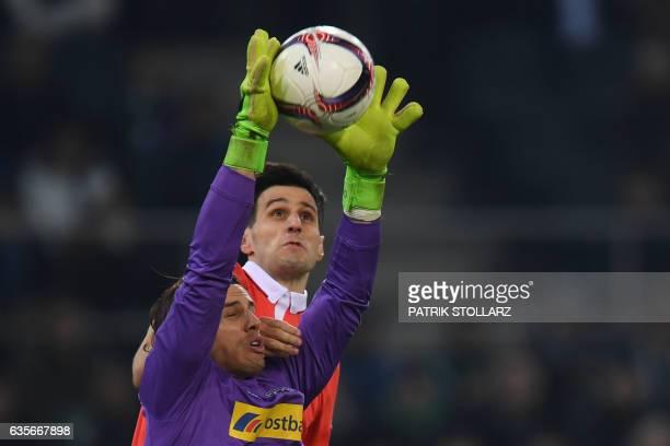 Moenchengladbach's Swiss goalkeeper Yann Sommer makes a save during the UEFA Europa League round of 32 firstleg football match between Borussia...