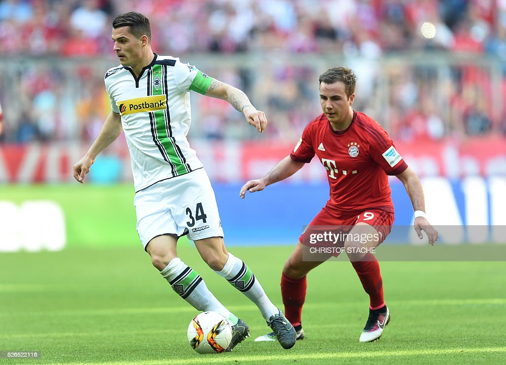 Moenchengladbach's Swiss midfielder Granit Xhaka (L) and Bayern Munich's midfielder Mario Goetze vie for the ball during the German first division Bundesliga football match Bayern Munich vs Borussia Moenchengladbach in Munich, southern Germany, on April 30, 2016. / AFP / CHRISTOF