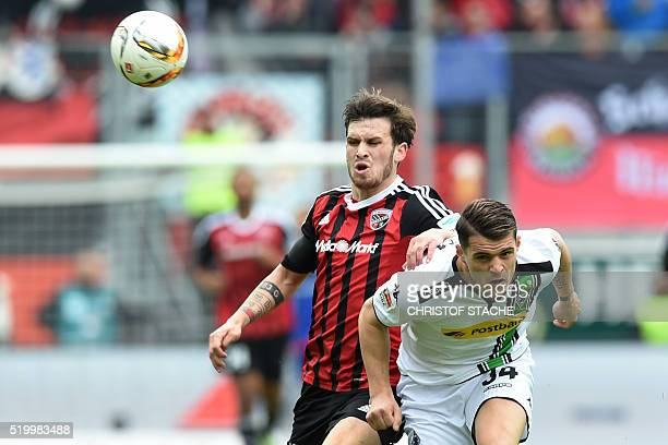 Moenchengladbach's Swiss midfielder Granit Xhaka and Ingolstadt's midfielder Pascal Gross vie for the ball during the German Bundesliga first...