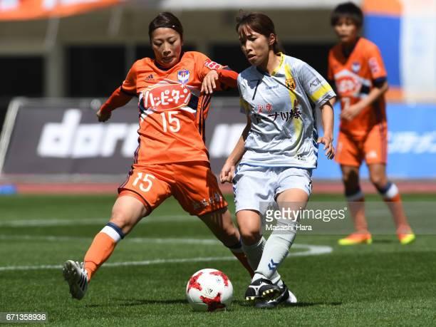 Moeno Sakaguchi of Albirex Nigata and Emi Nakajima of INAC Kobe Leonessa compete for the ball during the Nadeshiko League match between Albirex...
